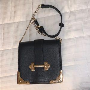 Olivia Miller black and gold mini handbag
